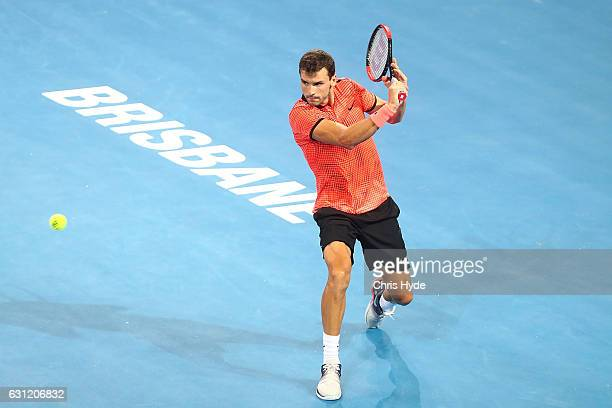 Grigor Dimitrov of Bulgaria plays a backhand in the Men's Final match against Kei Nishikori of Japan during day eight of the Brisbane international...