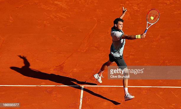 Grigor Dimitrov of Bulgaria plays a backhand volley against Xavier Malisse of Belgium in their first round match during day one of the ATP Monte...