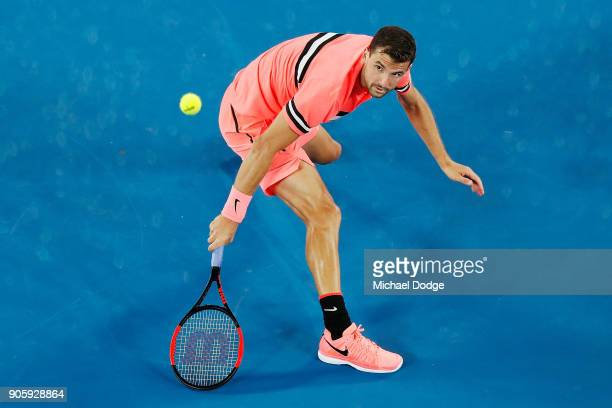Grigor Dimitrov of Bulgaria plays a backhand volley in his second round match against Mackenzie McDonald of the United States on day three of the...