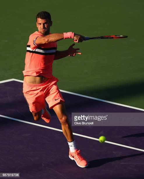 Grigor Dimitrov of Bulgaria plays a forehand against Jeremy Chardy of France in their third round match during the Miami Open Presented by Itau at...