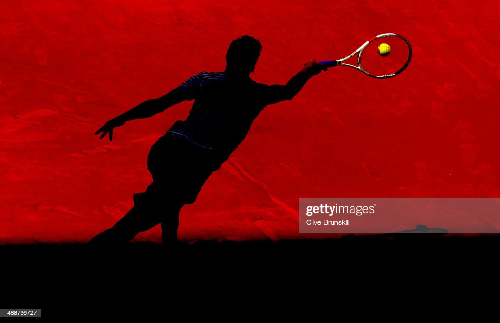 Grigor Dimitrov of Bulgaria plays a forehand against Tomas Berdych of the Czech Republic in their third round match during day six of the Mutua Madrid Open tennis tournament at the Caja Magica on May 8, 2014 in Madrid, Spain.