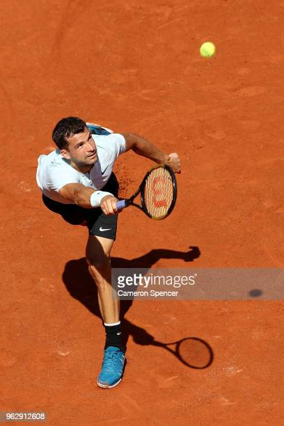 Grigor Dimitrov of Bulgaria plays a forehand during his first round men's singles match against Mohamed Safwat of Egypt on day one of the French Open...