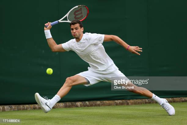 Grigor Dimitrov of Bulgaria plays a forehand during his Gentlemen's Singles first round match against Simone Bolelli of Italy on day two of the...