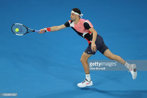 Grigor Dimitrov of Bulgaria plays a forehand during his Men's Singles first round match against Juan Ignacio Londero of Argentina on day one of the...