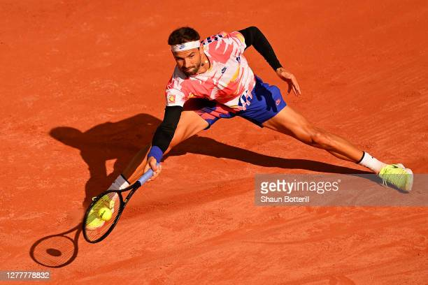 Grigor Dimitrov of Bulgaria plays a forehand during his Men's Singles second round match against Andrej Martin of Slovakia on day five of the 2020...