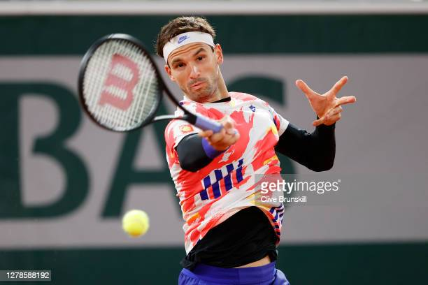 Grigor Dimitrov of Bulgaria plays a forehand during his Men's Singles fourth round match against Stefanos Tsitsipas of Greece on day nine of the 2020...