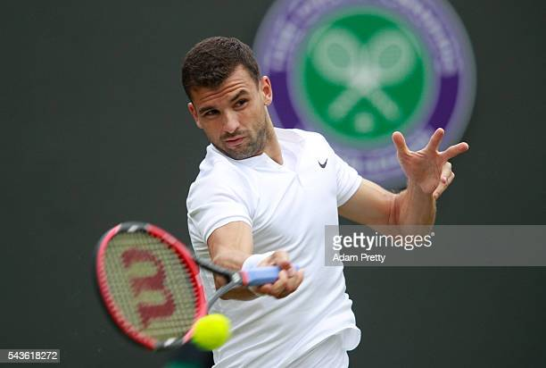 Grigor Dimitrov of Bulgaria plays a forehand during the Men's Singles second round match against Gilles Simon of France on day three of the Wimbledon...