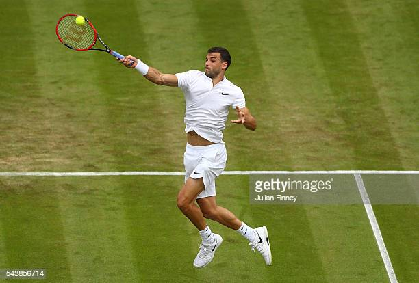 Grigor Dimitrov of Bulgaria plays a forehand during the Men's Singles second round match against Gilles Simon of France on day four of the Wimbledon...