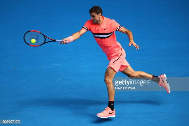Grigor Dimitrov of Bulgaria plays a forehand in his first round match against Dennis Novak of Austria on day one of the 2018 Australian Open at...