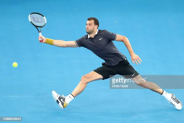 Grigor Dimitrov of Bulgaria plays a forehand in his match against John Millman of Australia during day four of the 2019 Brisbane International at Pat...