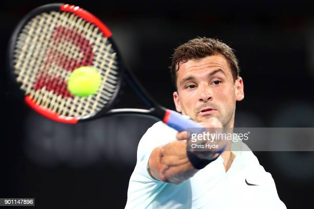 Grigor Dimitrov of Bulgaria plays a forehand in his match against John Millman of Australia during day five of the 2018 Brisbane International at Pat...