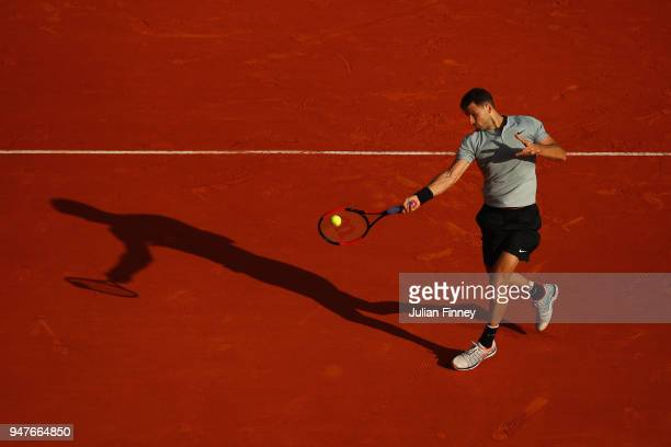 Grigor Dimitrov of Bulgaria plays a forehand in his match against PierreHugues Herbert of France during Day Three of the ATP Masters Series Monte...