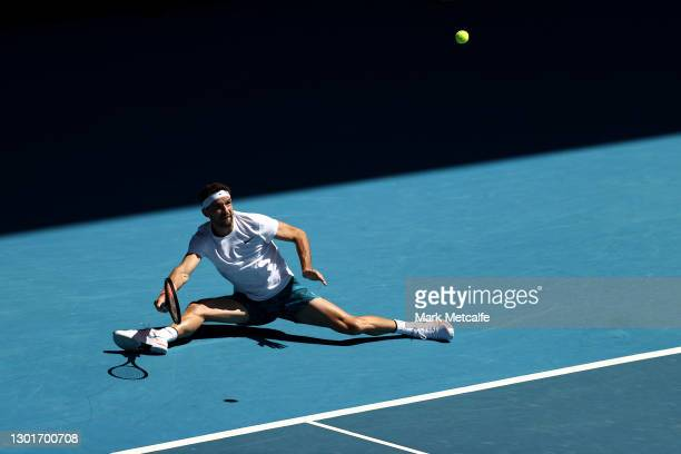 Grigor Dimitrov of Bulgaria plays a forehand in his Men's Singles third round match against Pablo Carreno Busta of Spain during day five of the 2021...