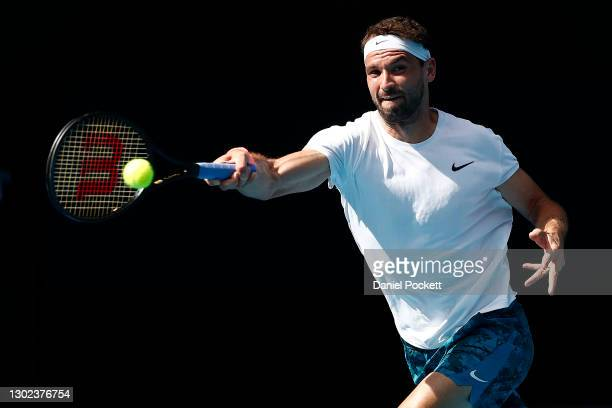Grigor Dimitrov of Bulgaria plays a forehand in his Men's Singles Quarterfinals match against Aslan Karatsev of Russia during day nine of the 2021...
