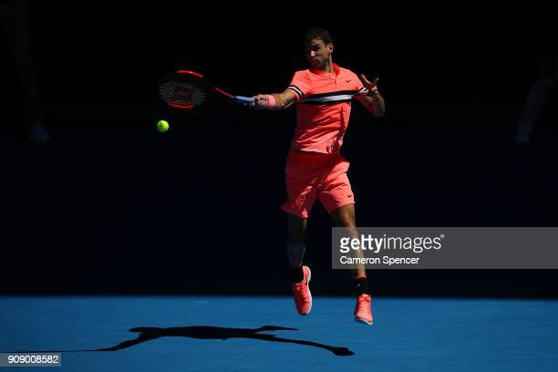 Grigor Dimitrov of Bulgaria plays a forehand in his quarterfinal match against Kyle Edmund of Great Britain on day nine of the 2018 Australian Open...