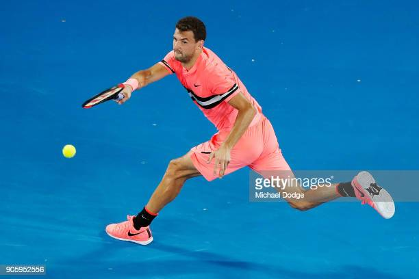 Grigor Dimitrov of Bulgaria plays a forehand in his second round match against Mackenzie McDonald of the United States on day three of the 2018...