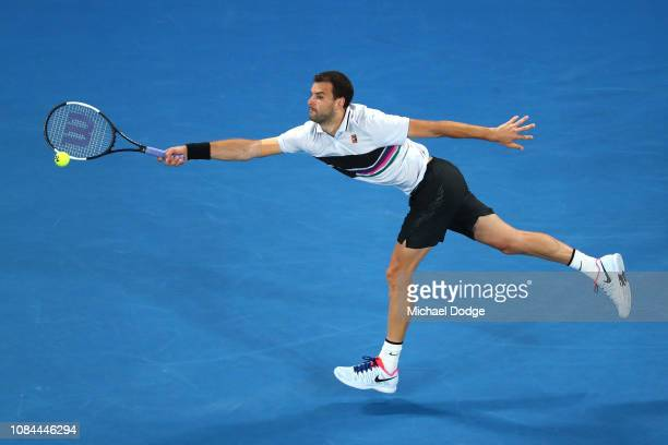 Grigor Dimitrov of Bulgaria plays a forehand in his third round match against Thomas Fabbiano of Italy during day five of the 2019 Australian Open at...