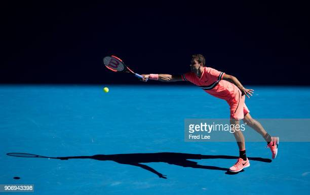 Grigor Dimitrov of Bulgaria plays a forehand in his third round match against Andrey Rublev of Russia on day five of the 2018 Australian Open at...