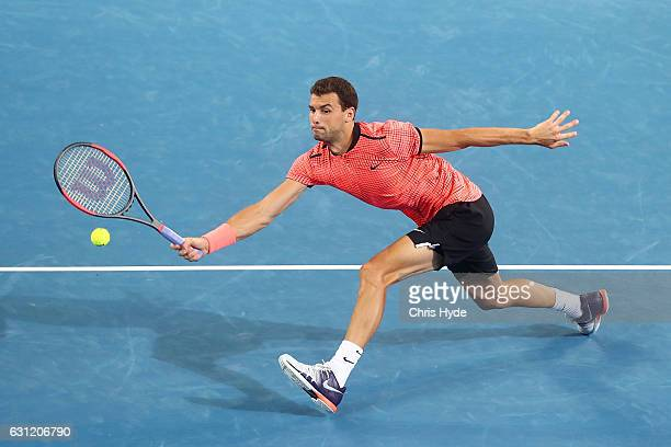 Grigor Dimitrov of Bulgaria plays a forehand in the Men's Final match against Kei Nishikori of Japan during day eight of the Brisbane international...