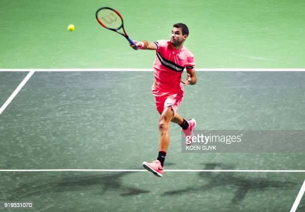 Grigor Dimitrov of Bulgaria plays a forehand return during his semifinal singles match against David Goffin of Belgium for the ABN AMRO World Tennis...