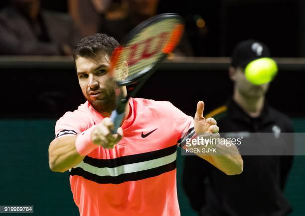 Grigor Dimitrov of Bulgaria plays a forehand return to Roger Federer of Switzerland during their men's singles final for the ABN AMRO World Tennis...