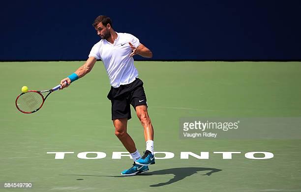 Grigor Dimitrov of Bulgaria plays a shot against Kei Nishikori of Japan during Day 5 of the Rogers Cup at the Aviva Centre on July 29 2016 in Toronto...