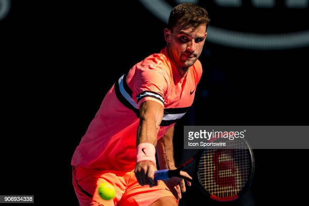 Grigor Dimitrov of Bulgaria plays a shot in his third round match during the 2018 Australian Open on January 19 at Melbourne Park Tennis Centre in...