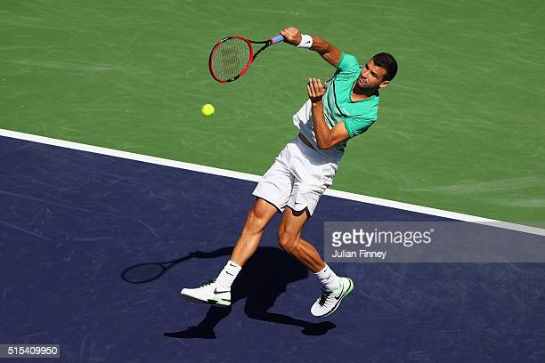 Grigor Dimitrov of Bulgaria plays a smash in his match against Alexander Zverev of Germany during day seven of the BNP Paribas Open at Indian Wells...