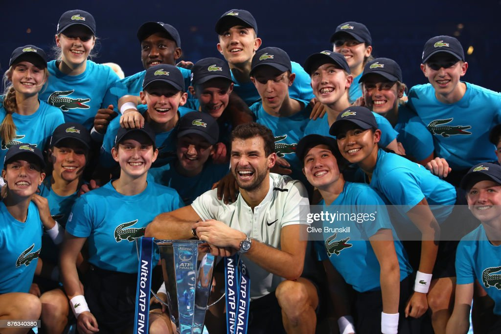 Grigor Dimitrov of Bulgaria poses for photos with the ball boys and girls following his victory in the singles final against David Goffin of Belgium during day eight of the 2017 Nitto ATP World Tour Finals at O2 Arena on November 19, 2017 in London, England.
