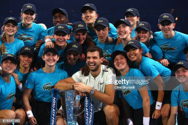 Grigor Dimitrov of Bulgaria poses for photos with the ball boys and girls following his victory in the singles final against David Goffin of Belgium...