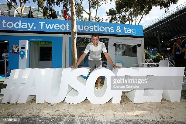 Grigor Dimitrov of Bulgaria poses with the Australian Open twitter hashtag at the Social Shack in Garden Square during day 2 of the 2014 Australian...