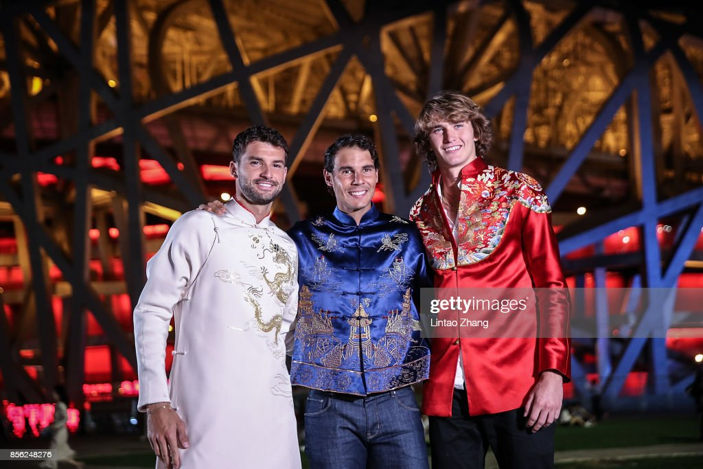Grigor Dimitrov of Bulgaria, Rafael Nadal of Spain, Juan Martin Del Potro of Argentina and Alexander Zverev of Germany, poses for a picture front of the National Stadium before the 2017 China Open Player Party on October 1, 2017 in Beijing, China.