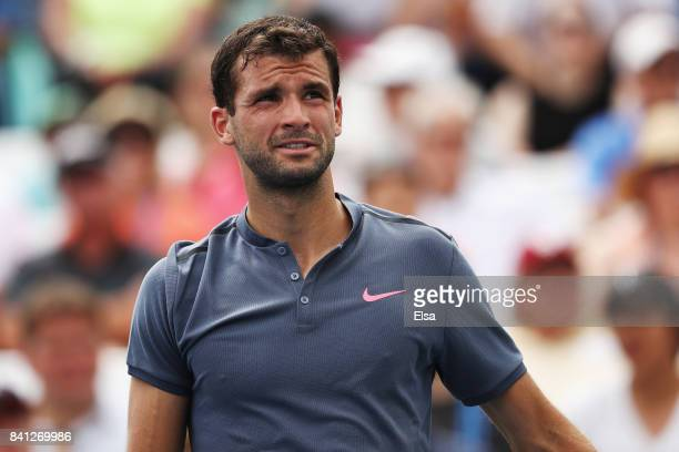 Grigor Dimitrov of Bulgaria reacts against Andrey Rublev of Russia during their second round Men's Singles match on Day Four of the 2017 US Open at...