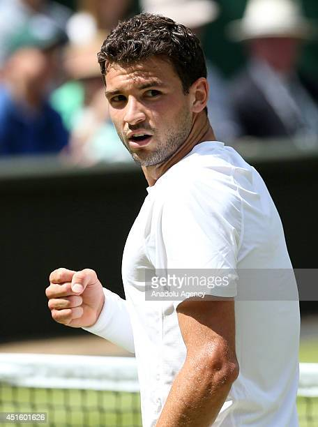 Grigor Dimitrov of Bulgaria reacts during his Gentlemen's Singles quarterfinal match against Andy Murray of Great Britain on day nine of the...