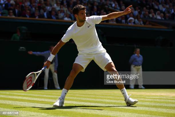 Grigor Dimitrov of Bulgaria reacts during his Gentlemen's Singles semifinal match against Novak Djokovic of Serbia on day eleven of the Wimbledon...