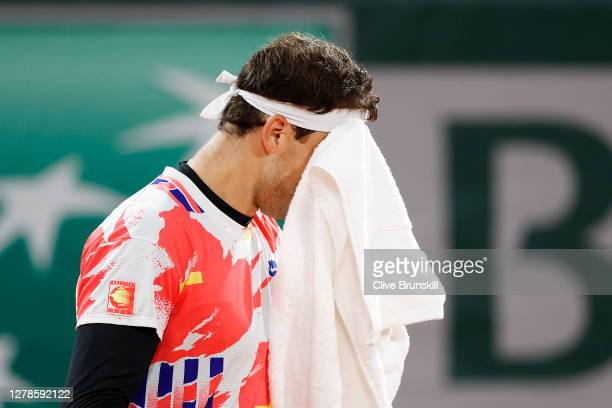 Grigor Dimitrov of Bulgaria reacts during his Men's Singles fourth round match against Stefanos Tsitsipas of Greece on day nine of the 2020 French...