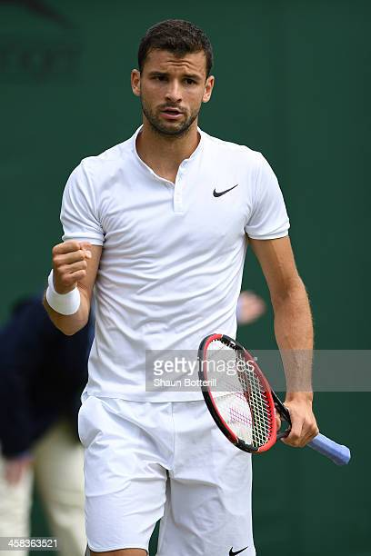 Grigor Dimitrov of Bulgaria reacts during the Men's Singles third round match against Steve Johnson of The United States on day six of the Wimbledon...
