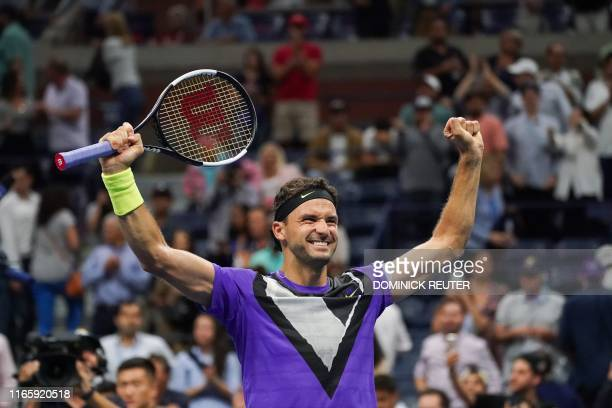 Grigor Dimitrov of Bulgaria reacts to his win against Roger Federer of Switzerland in their Men's Singles Quarterfinals tennis match during the 2019...