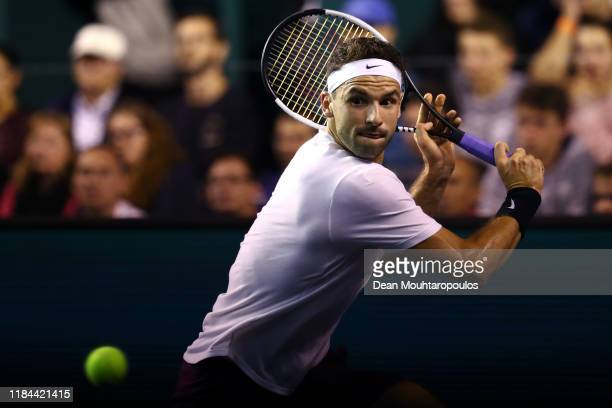 Grigor Dimitrov of Bulgaria returns a backhand in his match against David Goffin of Belgium on day 3 of the Rolex Paris Masters, part of the ATP...
