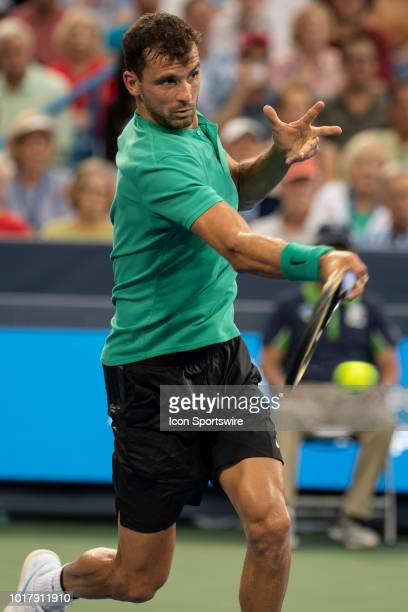 Grigor Dimitrov of Bulgaria returns a ball to Novak Djokovic of Serbia during Day 5 of the Western and Southern Open at the Lindner Family Tennis...
