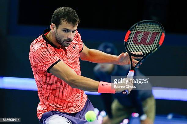 Grigor Dimitrov of Bulgaria returns a shot against Andy Murray of Great Britain during the Men's Singles final on day nine of the 2016 China Open at...
