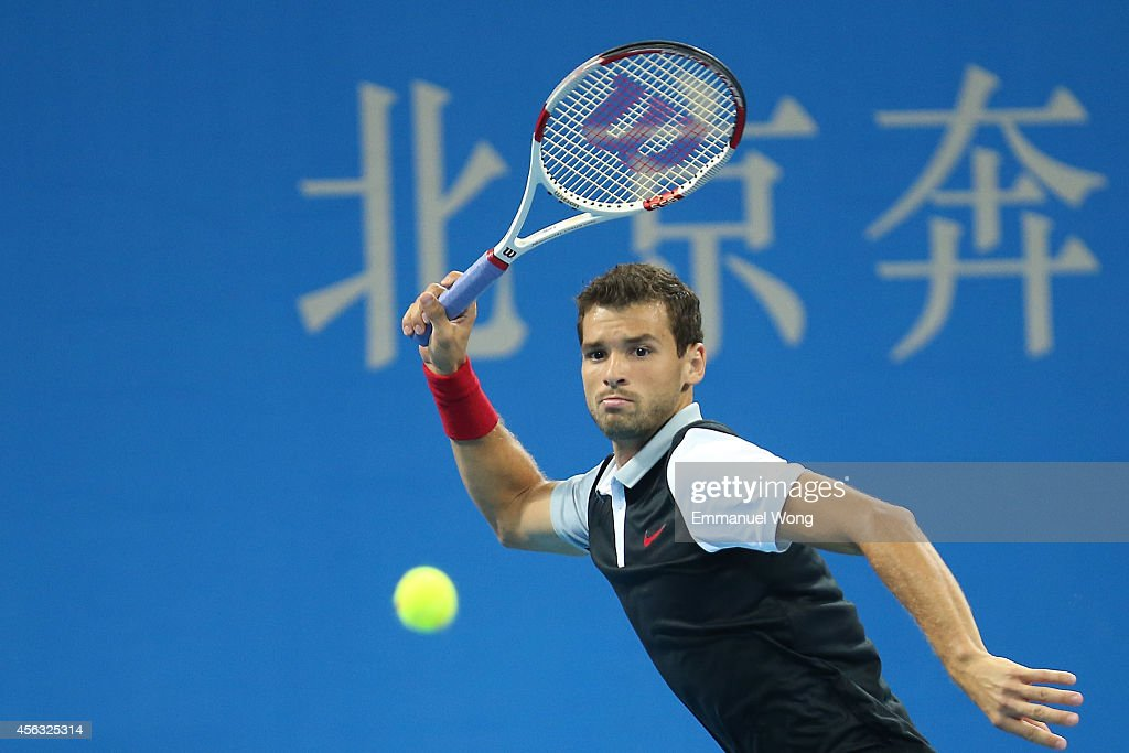 Grigor Dimitrov of Bulgaria returns a shot against Fernando Verdasco of Spain during day three of the China Open at the China National Tennis Center on September 29, 2014 in Beijing, China.