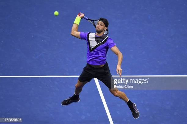 Grigor Dimitrov of Bulgaria returns a shot during his Men's Singles semi-final match against Daniil Medvedev of Russia on day twelve of the 2019 US...