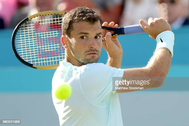 Grigor Dimitrov of Bulgaria returns a shot during his men's singles match aganst Novak Djokovic of Serbia on Day Four of the FeverTree Championships...