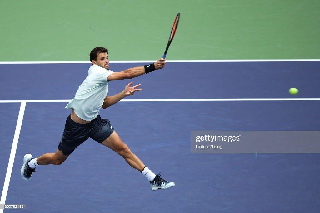 Grigor Dimitrov of Bulgaria returns a shot during Men's singles quarter final mach against Rafael Nadal of Spain on day six of 2017 ATP Shanghai Rolex Masters at Qizhong Stadium on October 13, 2017 in Shanghai, China.