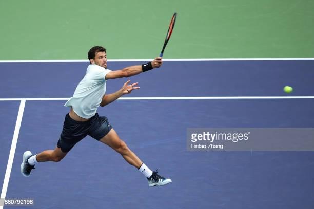 Grigor Dimitrov of Bulgaria returns a shot during Men's singles quarter final mach against Rafael Nadal of Spain on day six of 2017 ATP Shanghai...