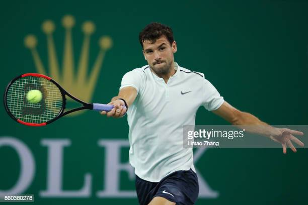 Grigor Dimitrov of Bulgaria returns a shot during the Men's singles mach third round against Sam Querrey of the United States on day five of 2017 ATP...