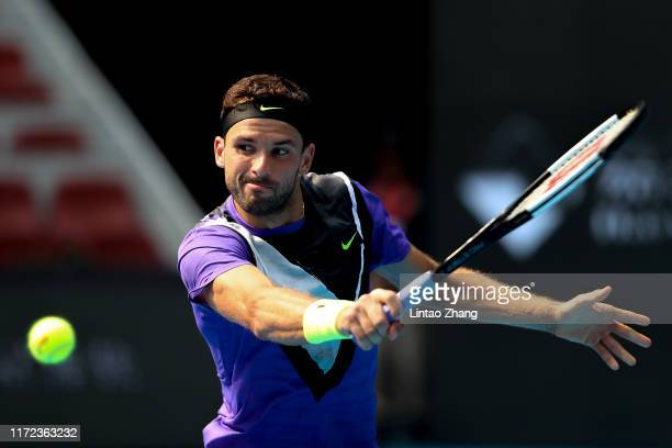 Grigor Dimitrov of Bulgaria returns a shot in the Men's singles first round match against Andrey Rublev of Russia of 2019 China Open at the China...
