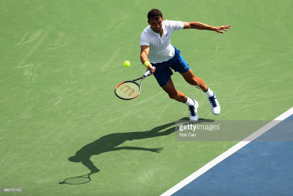 Grigor Dimitrov of Bulgaria returns a shot to Feliciano Lopez of Spain during Day 5 of the Western & Southern Open at the Linder Family Tennis Center on August 16, 2017 in Mason, Ohio.
