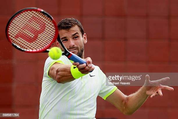 Grigor Dimitrov of Bulgaria returns a shot to Joao Sousa of Portugal during his third round Men's Singles match on Day Six of the 2016 US Open at the...